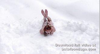 Russian redhead Greta in snow bondage. Part 2