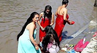 indian women outdoor bathing hot
