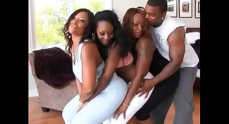 Black stunner with big phat ass rides throbbing cock in an orgy