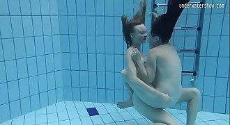 Two hot lesbians in the pool loving eachother