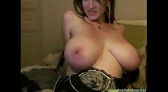 A truly natural big boobed slim beauty masturbating on cam